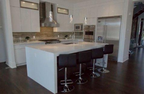Persian Silver Bolder Stone panel installed as a kitchen backsplash