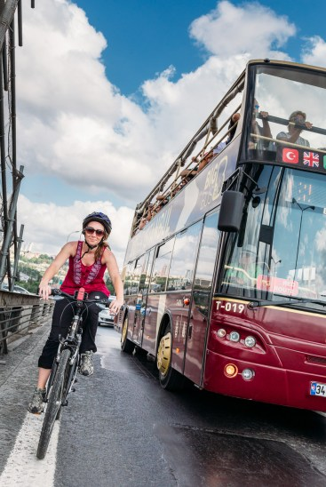 Biking next to double decker bridges as we get the rare opportunity to bike Istanbul's Bosphorus