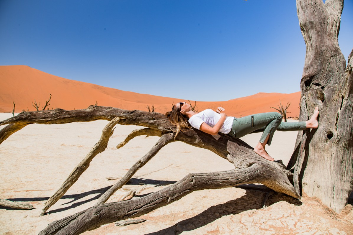 Relaxing among the odd petrified forest of Deadvlei in Namib Naukluft National Park