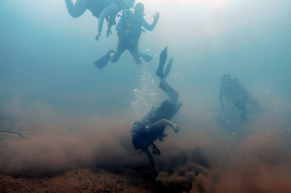 Another dive master goes head first into the sand at Barracuda Lake Coron Philippines