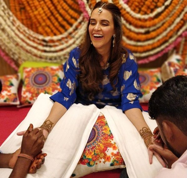 Neha Dhupia flashes a million dollar smile in her mehendi ceremony – view pics