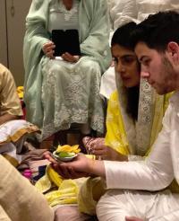 Parineeti chopra twinned with priyanka on her engagement  Priyanka Chopra's Wedding Lehenga To Be Designed By Abu Jani-Sandeep Khosla, Took 6 Hrs To Finalise? article 2018822916401860018000