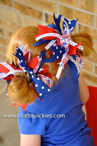 back of girl's head wearing firecracker bows