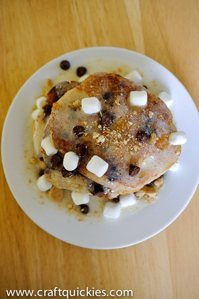 This s'mores pancakes recipe from Craft Quickies is the ultimate decadent brunch item! Graham-cracker buttermilk pancakes with s'mores fixings!