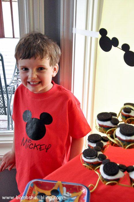 Birthday boy at dessert table at disney birthday party