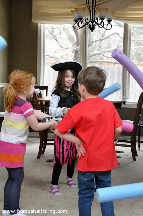 Kids playing with light sabers at disney birthday party