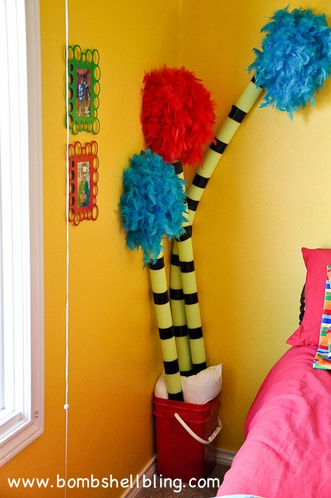 Make truffula trees using pool noodles and feather boas! BRILLIANT!! Perfect for any Dr. Seuss themed room whether it's a classroom or a bedroom!