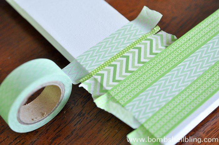 Placing green washi tape on white frame