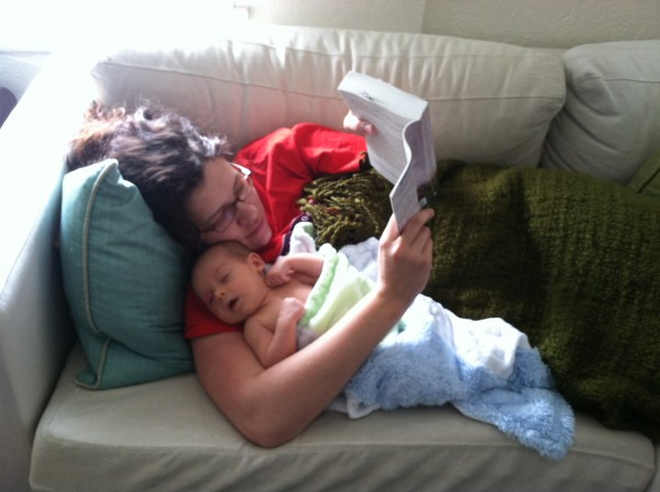 In San Diego snuggling my brand new nephew and reading The Secret Keeper = Heaven.