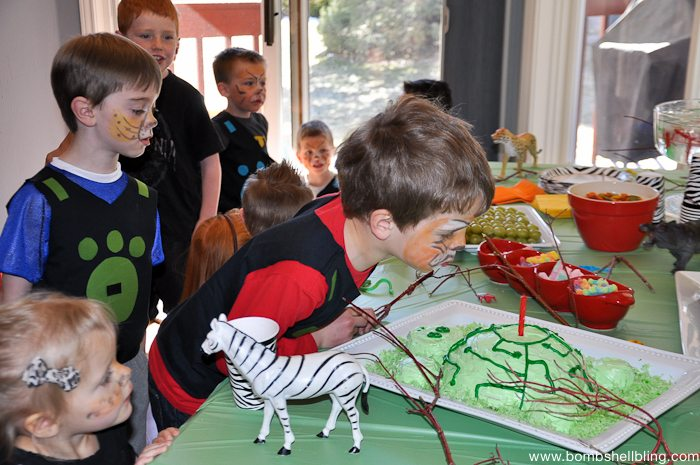 Boy blowing out candles at Wild Kratts Birthday Party