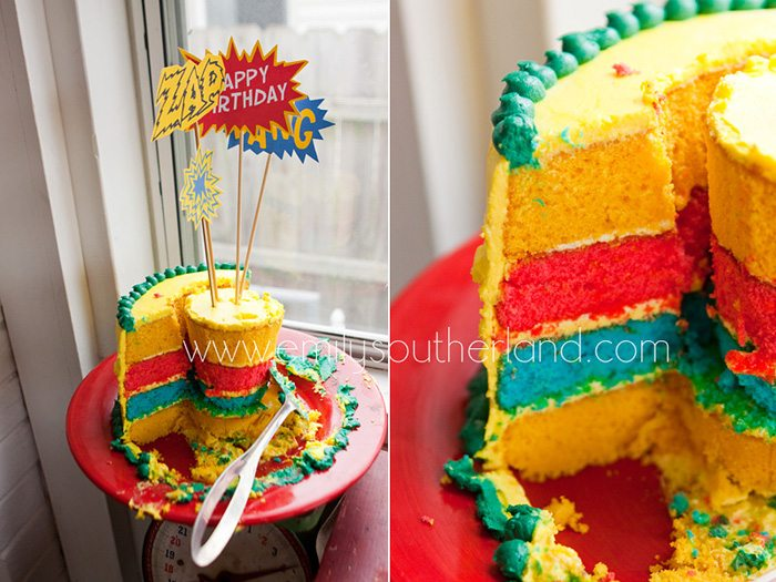 Superhero birthday party cut birthday cake close up