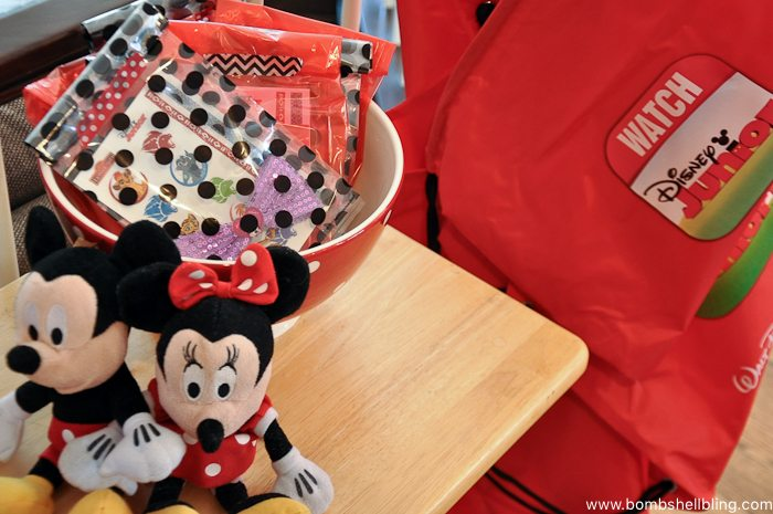 Red party favor bags at disney junior birthday party