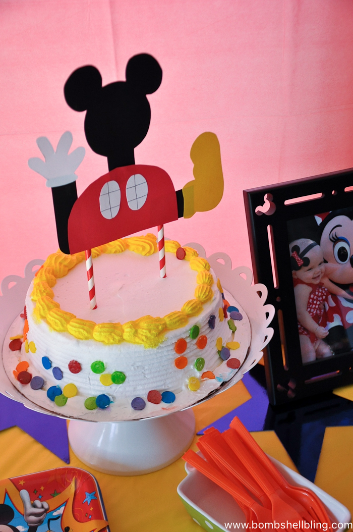 Cake with white frosting and multicolored polka dots for disney junior birthday party