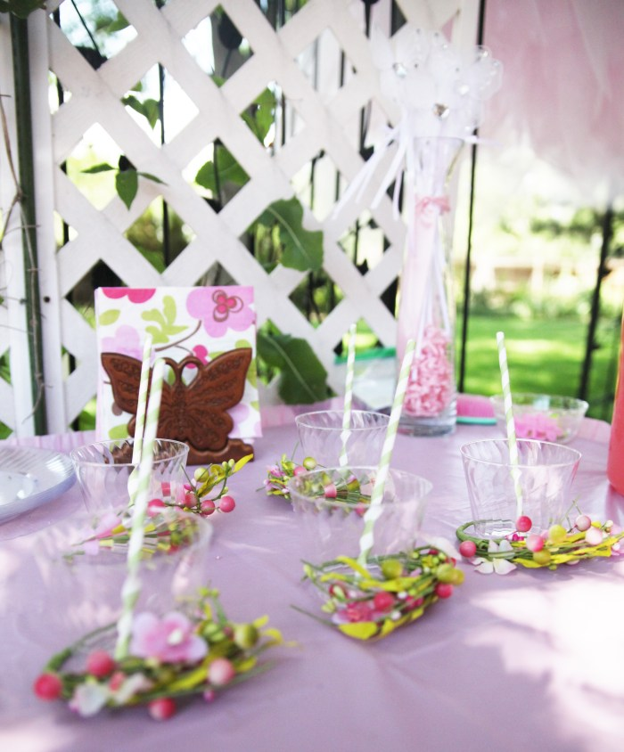 Clear plastic cups with striped straw on table at fairy birthday party