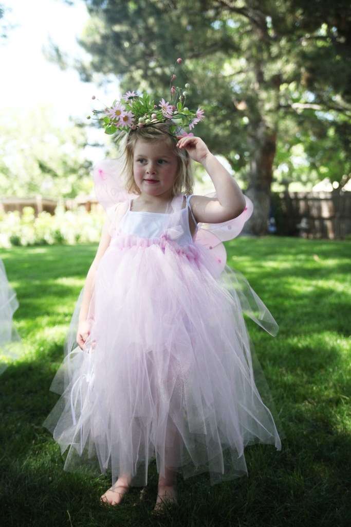 Girl in pink fairy costume at fairy birthday party