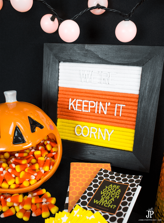 This adorable handmade felt letter board in candy can colors DIY will save you money making this festive and fun decor item for your Halloween home!
