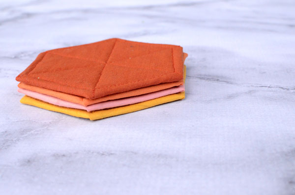 These modern hexagon fabric coasters are easy to sew and make a stylish place to set your glass.