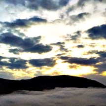 mtns-in-clouds-at-sunset