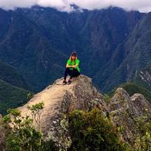 Machu Picchu Huanapicchu ledge seated