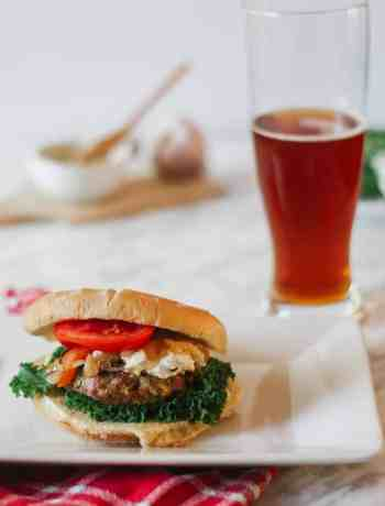 healthier ratatouille turkey burger with an amber beer on the side