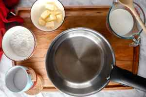 Empty pot surrounded with ingredients, mise en place