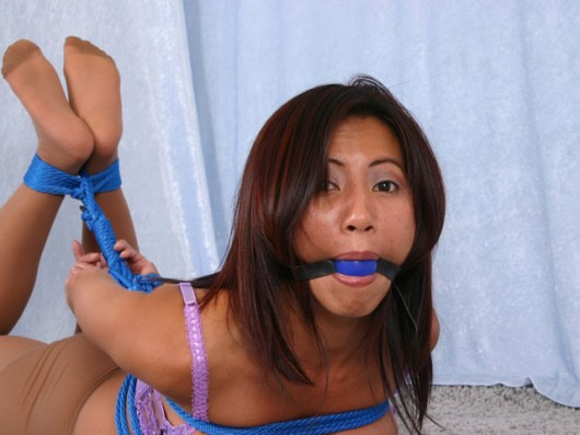 Slutty Asian Chick is tightly hogtied and gagged in Lingerie