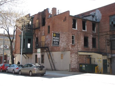 View from the northwest, showing the west (rear) side of the building.  Those who had been to the Play House may recall that the third floor was split, with a lower area in back, and the main dungeon area on that floor being higher up to accommodate the higher ceiling on the second floor.