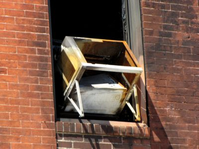 An air conditioning unit on the east facade appeared gutted, and leaned back into the building.  Of all of the things on the building, this made me the most nervous, as this seemed like it presented an imminent danger of falling onto those on the street below.