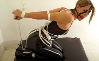 Beautiful Young Blonde in Latex and Heels Bound, Harnessed and Gagged