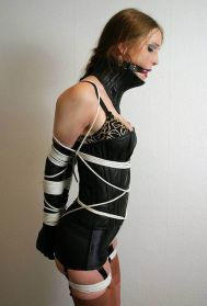 Beautiful Young Brunette in Corset Harnessed, Gagged and Disciplined