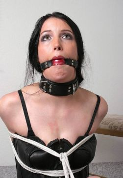 Beutiful Brunette in Leather Gets Tightly Bound, Gagged and Collared