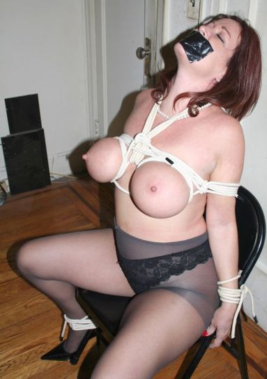 Busty Brunette Slave in Stockings Gets Tightly Bound and Disciplined