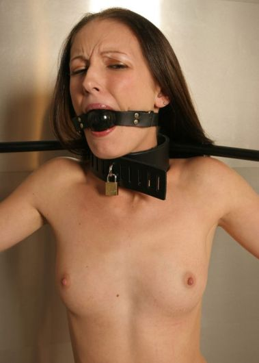 Cute Skinny Brunette in Heels Collared, Ball Gagged and Restrained