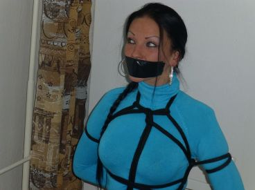 Gorgeous Brunette Gets Bound and Tape Gagged at Home for Discipline