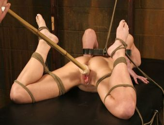 Hot Brunette Tightly Bound, Ball Gagged and Penetrated in the Dungeon
