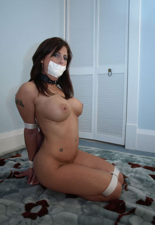 Hot Busty Brunette Gets Tightly Bound and Tape Gagged for Discipline