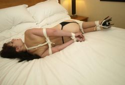 Pretty Girlfriend in Garters Ball Gagged and Hogtied in a Hotel Room