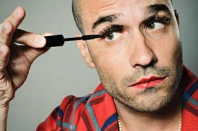 man applying mascara