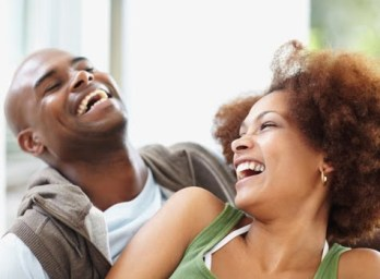 photograph man and woman in relationship laughing