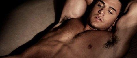Black muscular topless man