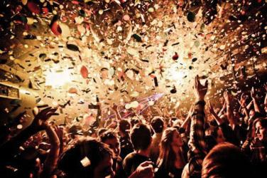 Confetti falling to a crowd in a big party