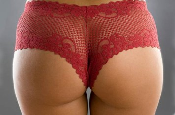 Photo of woman's bottom wearing red lace underwear