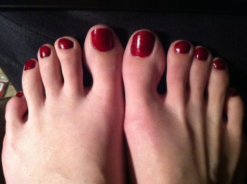 Pedicured feet with red nails