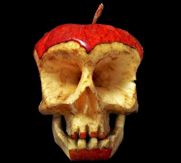 "These skull-ful creations are sure to turn heads.....Artist Dimitri Tsykalov uses an axe, saw and electrical drill to carve human skulls out of fresh fruit and vegetables..The 48-year-old then uses a scalpel, pincers and cotton wool pads to add and smooth remarkable detail with ""surgical precision"". PLEASE SEE OUR COPY FOR FULL STORY...Pictured: A skull made from an apple...© Dimitri Tsykalov/Solent News.Supplied by Solent News & Photo Agency.UK +44 (0) 2380 458800."