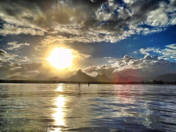 Stand Up Paddling at sunrise on the West Coast