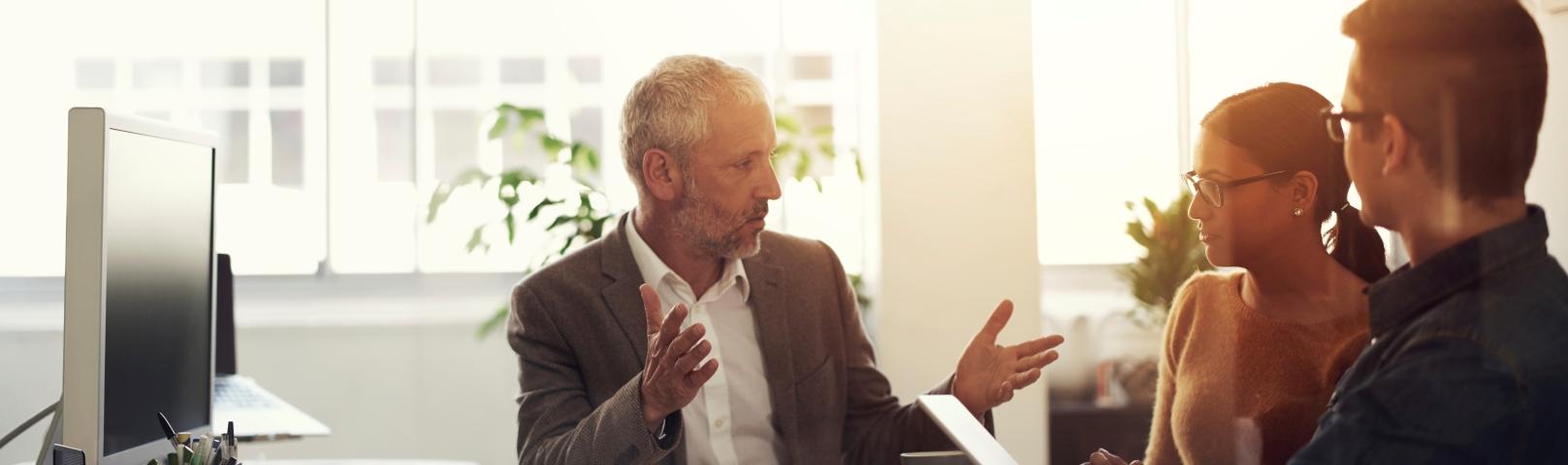 Man talking in board room meeting