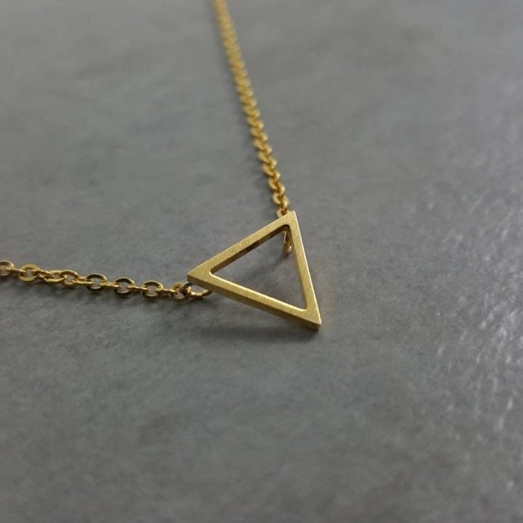 gold color simplistic necklace with minimalism triangle pura vida geometry