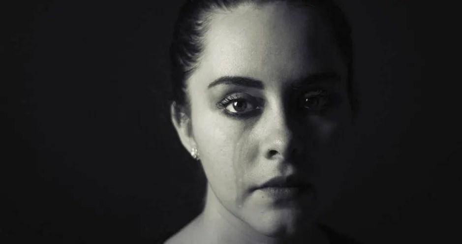 Woman sad because of husband's affair