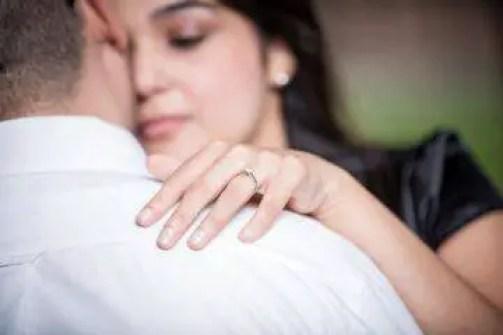 wife's hand on shoulder