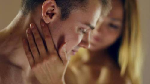 woman lovingly touches a man's face